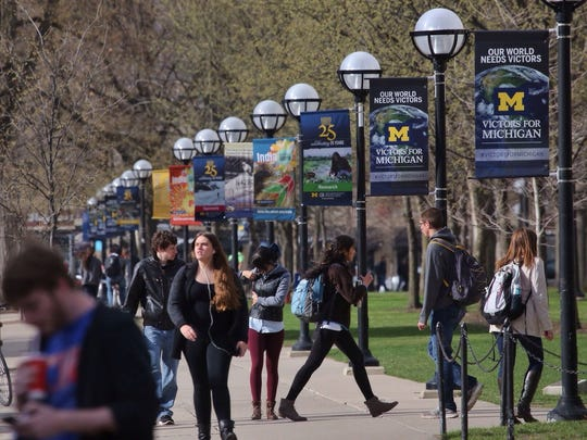 Students walk along South State Street through the