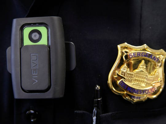 In this Jan. 22, 2015 photo, a body camera used by Des Moines Police Department school resource officers is worn by Sgt. Jason Halifax in Des Moines, Iowa. The rush by cities to outfit police officers with body cameras after last summer's unrest in Ferguson, Mo., is saddling local governments with steep costs for managing the volumes of footage they must keep for months or even years.