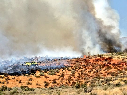 Crews are battling a wildfire that started Friday in