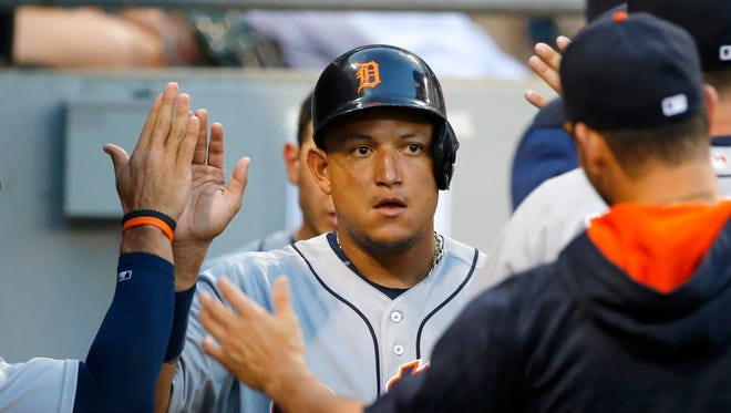 Detroit Tigers' Miguel Cabrera celebrates in the dugout after scoring on a single by Nick Castellanos during the third inning.
