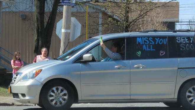 The Project Discovery staff drove their cars past the homes of each of their 62 students.