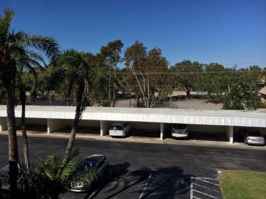A view of the proposed location of a 7-Eleven from the balcony of the adjoining condominium community on Cypress Lake Drive.