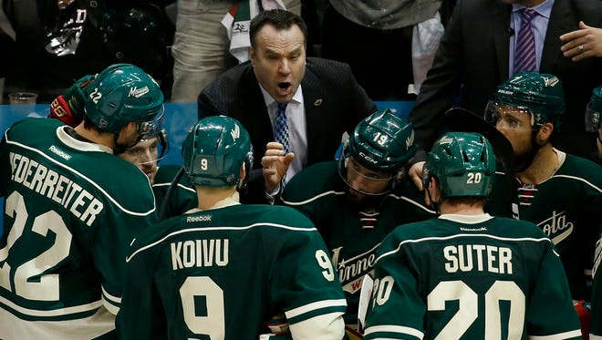 Wild head coach John Torchetti talks with his players during the third period of Game 6 in the first round of the NHL Stanley Cup playoffs Sunday.