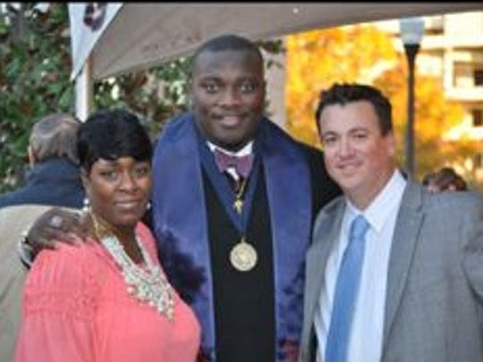"""Green Bay Packers rookie defensive lineman Montravius Adams poses with mother Debbie Young and """"God dad"""" Adam Langley at his college commencement. Adams is the first person in his family to receive a college diploma, graduating with a degree in interdisciplinary studies."""