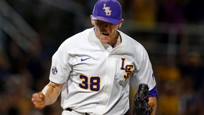 LSU pitcher Zack Hess reacts after striking out the last batter of the team's NCAA college baseball tournament super regional game against Mississippi State in Baton Rouge, La., Saturday, June 10, 2017. LSU won 4-3. (AP Photo/Gerald Herbert)