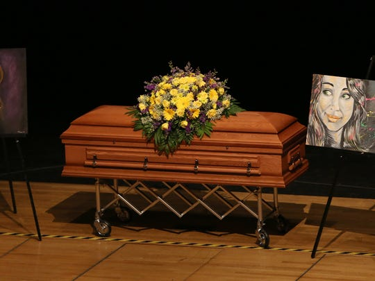 This Enquirer file photo was taken at a visitation and memorial service for Katelyn Markham at Fairfield High School Performing Arts Center in 2013.