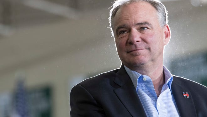 Democratic vice presidential candidate Sen. Tim Kaine, D-Va. listens as Democratic presidential candidate Hillary Clinton speaks during a campaign event at the Taylor Allderdice High School, Saturday, Oct. 22, 2016, in Pittsburgh, Pa. (AP Photo/Mary Altaffer)