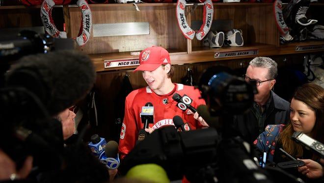 New Jersey Devils center Nico Hischier talks to reporters in the Devils lockerroom in Newark, NJ on Tuesday, April 10, 2018.