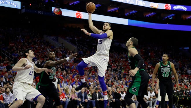 Philadelphia 76ers' Ben Simmons (25) goes up for a shot between Boston Celtics' Semi Ojeleye (37) and Jayson Tatum (0) during the first half of Game 3 of an NBA basketball second-round playoff series, Monday, May 7, 2018, in Philadelphia.