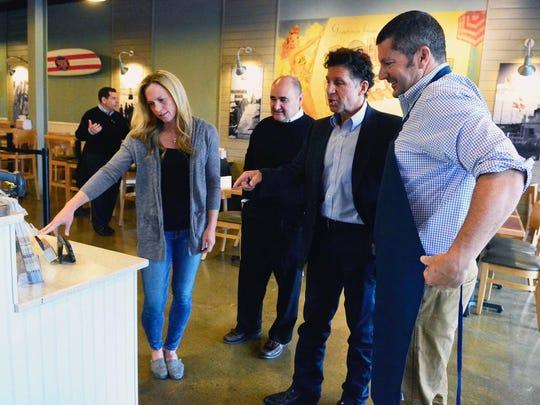Meeting at the Jersey Mike's location in Red Bank are (from right): Chris Rampone, Keith Hertling (Jersey Mike's vice president of franchise operations), John Hughes (Jersey Mike's brand ambassador) and Christie Rampone.
