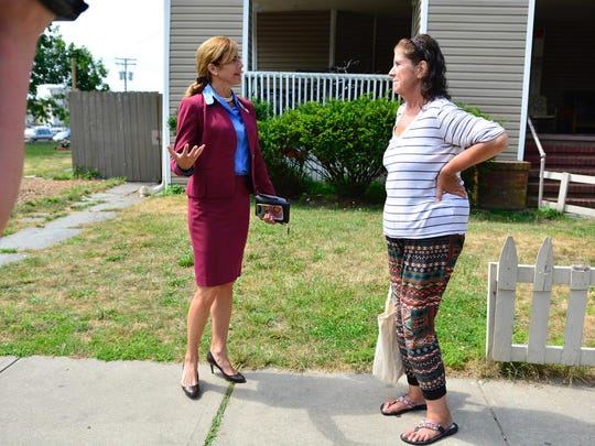 New Jersey State Senator Jen Beck (left) talks with Sandra Shaw a resident of the Del Monte Motel at 302 First Ave. in Asbury Park prior to a press conference there on Tuesday.