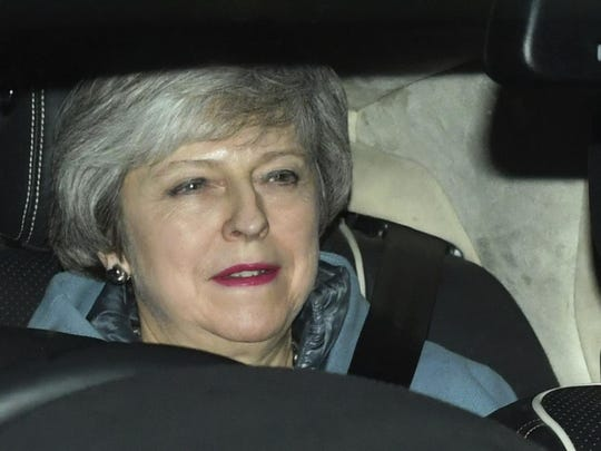 Britain's Prime Minister Theresa May leaves the Houses of Parliament in Westminster following a Brexit vote in the House of Commons, in London, Thursday Feb. 14, 2019. May suffered an embarrassing defeat by lawmakers Thursday in a vote that left her bid to secure a European Union divorce deal stuck between an intransigent EU and a resistant U.K. Parliament _ with Brexit just six weeks away. (Dominic Lipinski/PA via AP)