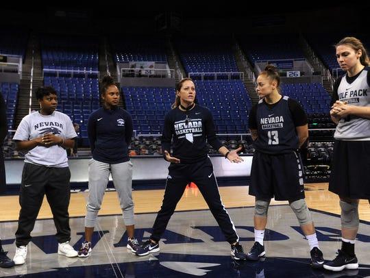 First year head women's basketball coach Amanda Levens,