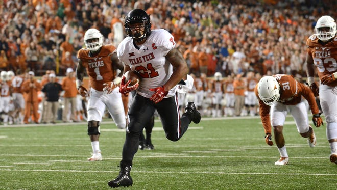 Texas Tech running back DeAndre Washington scores a touchdown during the second half.