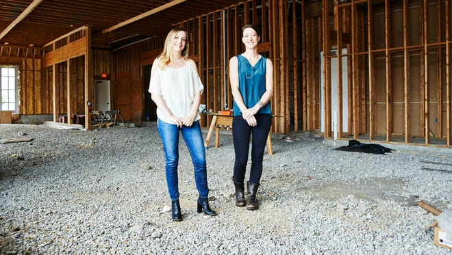 (l-r) Allie Poindexter and Julia Sullivan stand in the raw space at 4th and Madison that will become Henrietta Red, a new bistro and raw bar in Germantown.