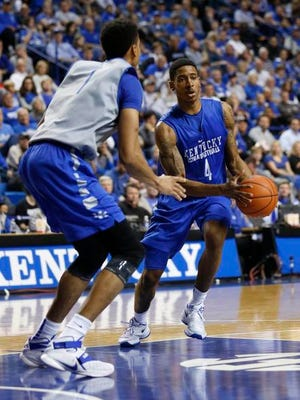 Oct 27, 2015; Lexington, Kentucky, USA; Kentucky Wildcats guard Charles Matthews (4) dribbles the ball against forward Skal Labissiere (1) in the second half of the Blue White scrimmage at Rupp Arena.