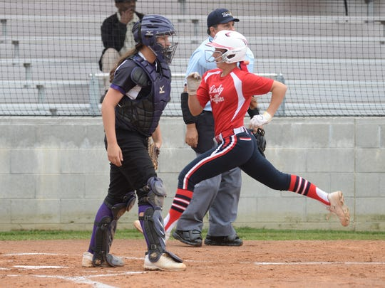 Bayli Simon sprints accross home plate to score in