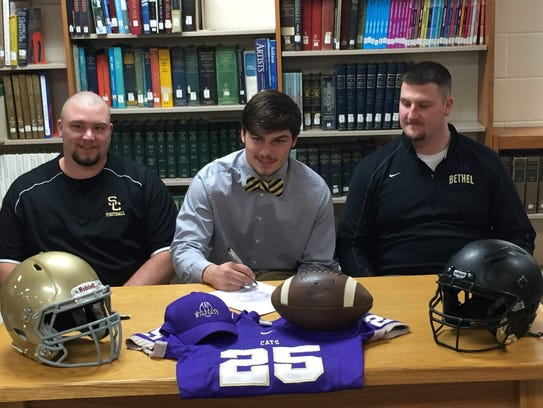 Taeton Wienk signs with Bethel University accompanied