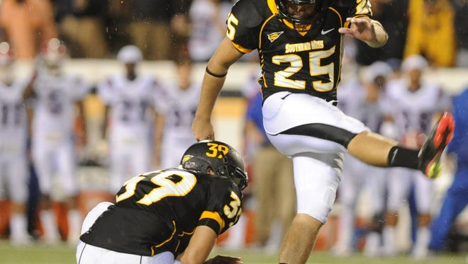 Southern Miss kicker Corey Acosta kicks a field goal during their game against Louisiana Tech./Photo by Ryan Moore