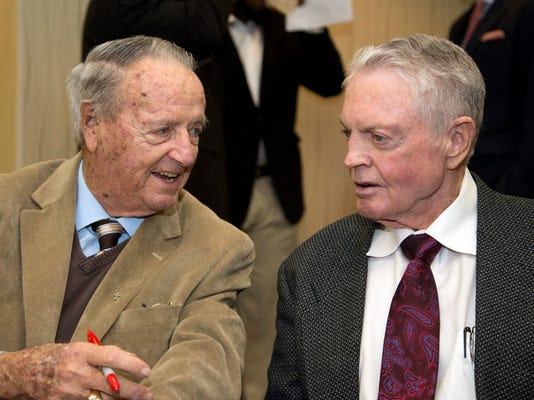 Retired Florida State coach Bobby Bowden, left, chats with retired Nebraska coach Tom Osborne in Omaha, Neb., Wednesday, Jan. 10, 2018. The 88-year-old Bowden is in Omaha to receive the Tom Osborne Legacy Award for his service to the game. (AP Photo/Nati Harnik)