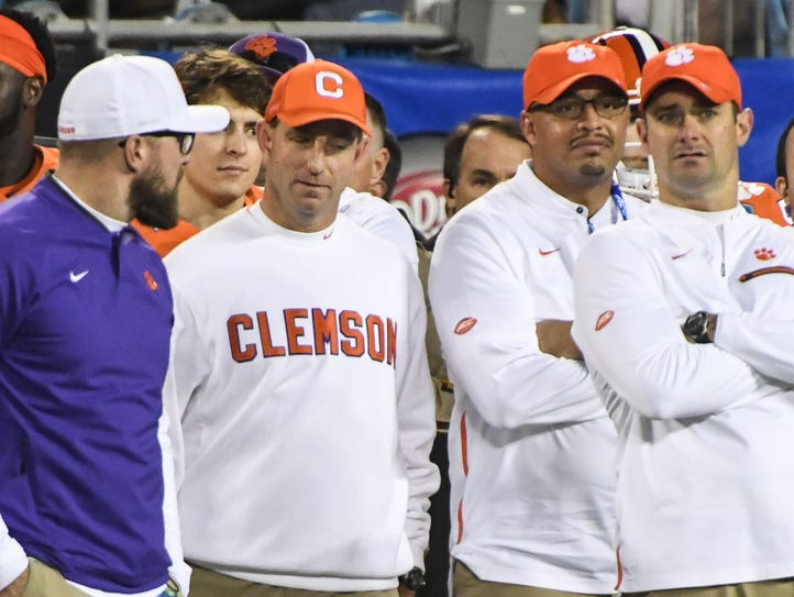 Clemson assistant Kyle Parker, left, head coach Dabo