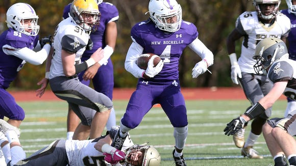 New Rochelle's Omari Walker (4) looks for some running room in the Clarkstown South defense during the Section 1 Class AA championship game at Mahopac High School Nov. 4, 2017.