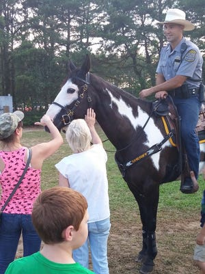 Ocean County Sheriff's Officer Brian Stockhoff with his horse, Sambuca, at the Ocean County Fair in Berkeley on July 15, 2016.