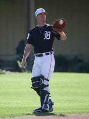 Jake Rogers plays catch during spring training Feb. 16.
