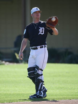 Tigers catcher Jake Rogers plays catch during spring training workouts on Friday, Feb. 16, 2018, at Joker Marchant Stadium in Lakeland, Fla.