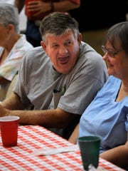 David Gill laughs while talking to a dining companion
