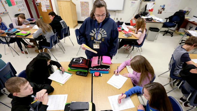 Eighth teacher Althea Vanevenhoven helps JR Gerritts Middle School students solve problems on a math worksheet on January 22, 2016 in Kimberly, Wis. Wm. Glasheen/USA TODAY NETWORK-Wisconsin