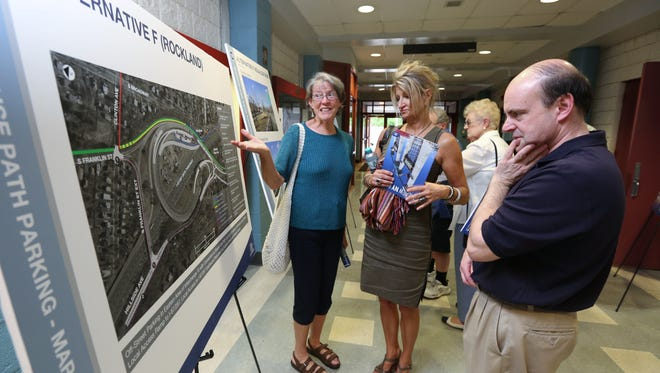 Midge Maier, left, Beate Stych and Neil Taylor look over a map of the planned terminus of the pedestrian path on the new Tappan Zee bridge during an annual public meeting of the New NY Bridge project at Nyack High School June 15, 2016.