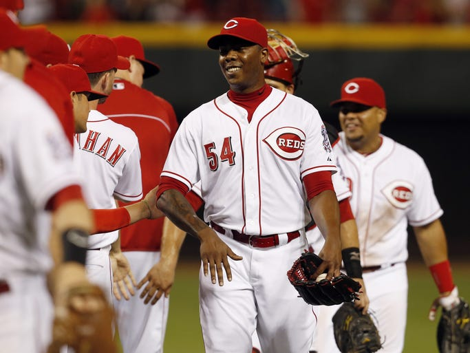 Cincinnati Reds relief pitcher Aroldis Chapman (54) was all smiles after earning a save against the Arizona Diamondbacks at Great American Ball Park.