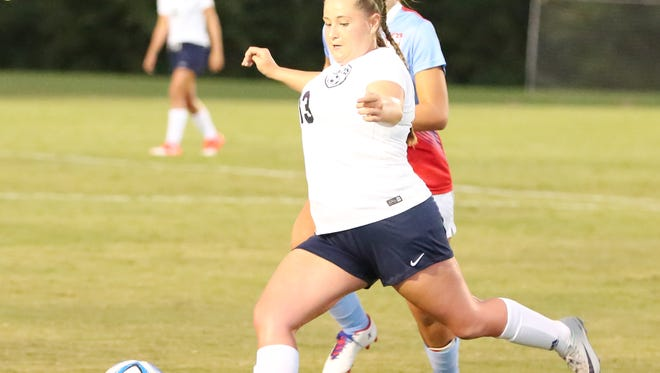 Madison's Camryn Meyer looks to pass the ball against USJ on Aug. 22.