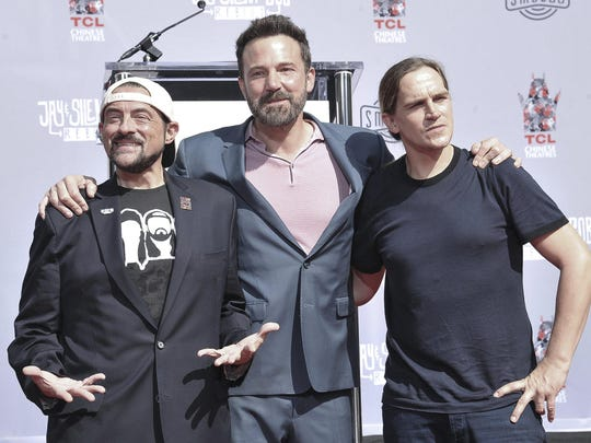 Kevin Smith, from left, Ben Affleck and Jason Mewes pose together at a hand and footprint ceremony for Smith and Mewes in the courtyard of the TCL Chinese Theatre on Monday, Oct. 14, 2019, in Los Angeles. (Photo by Richard Shotwell/Invision/AP)