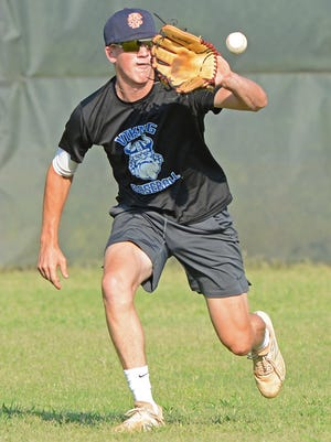 Sportsman outfielder Nick Phelps fields a ball during practice on Monday, July 20, 2020 at the Field of Dreams in Van Buren.