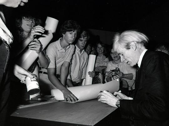 Warhol signed autographs for fans during his visit