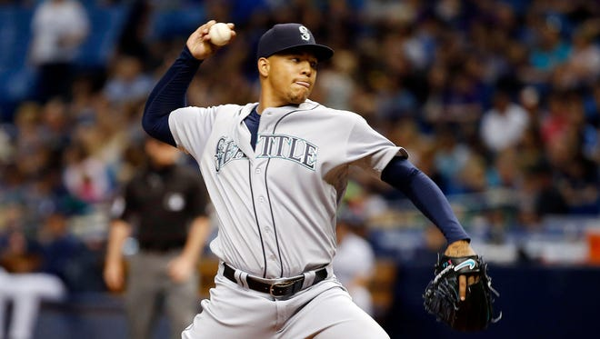 Mariners starting pitcher Taijuan Walker throws during the first inning at Tropicana Field.