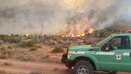 A U.S. Forest Service truck sits in front of the 2,000-acre Georges Fire burning near the Whitney Portal area.