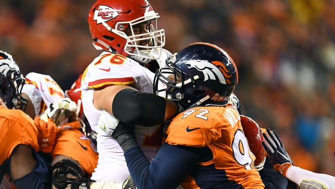 Denver Broncos nose tackle Sylvester Williams (92) pass rushes against Kansas City Chiefs offensive guard Laurent Duvernay-Tardif (76) in the second half at Sports Authority Field at Mile High.