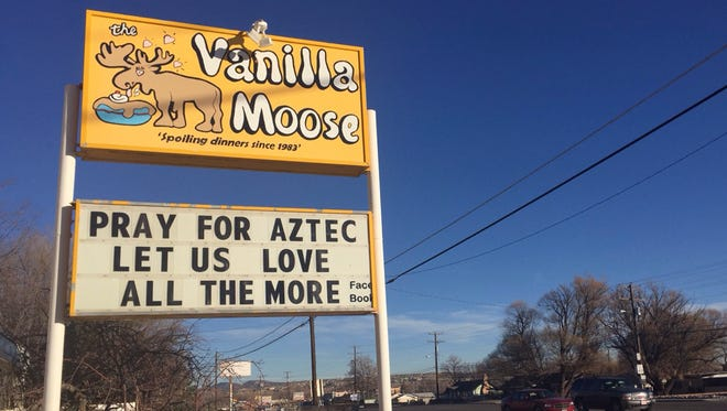 A sign encourages prayer outside an ice cream shop in Aztec, N.M., on Dec. 8, 2017, following this week's shooting at a high school.