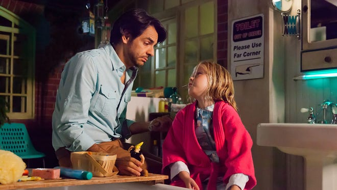 Eugenio Derbez, left, and Loreto Peralta anchor the bilingual box office hit 'Instructions Not Included.'