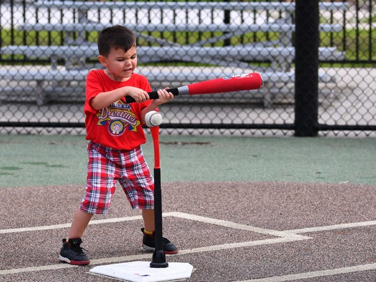 Jack DeRiggi gets ready to hit one off the tee during the last game of the Space Coast Field of Dreams baseball summer league.