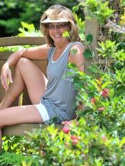 Owner Grace Mroczenski, of Hatley, poses for a photo at her garden.