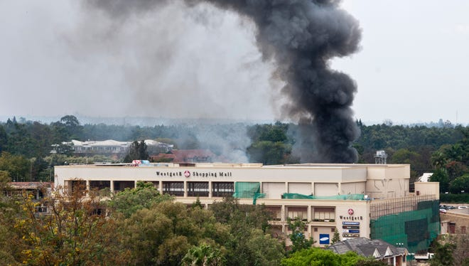 Smoke billows over the Westgate Mall in Nairobi, Kenya, on Sept. 23, 2013. Multiple large blasts have rocked the mall where a hostage siege is in its third day.