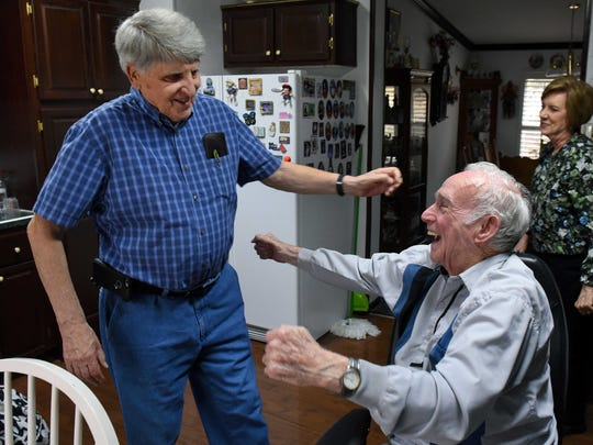 Mobile Meals client Don Hutchison, right, greets Charles