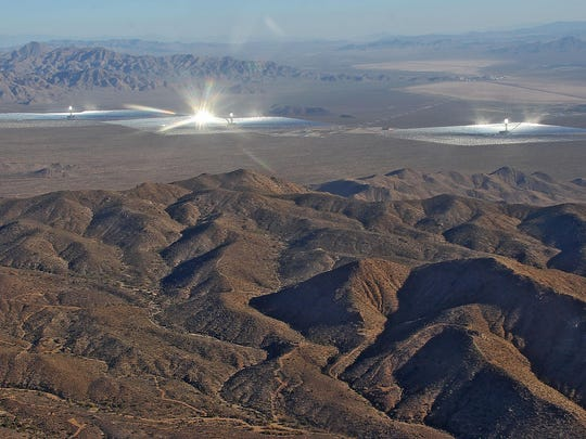 "The Ivanpah solar plant in San Bernardino County, which uses ""power tower"" technology, shines bright on Oct. 21, 2014."