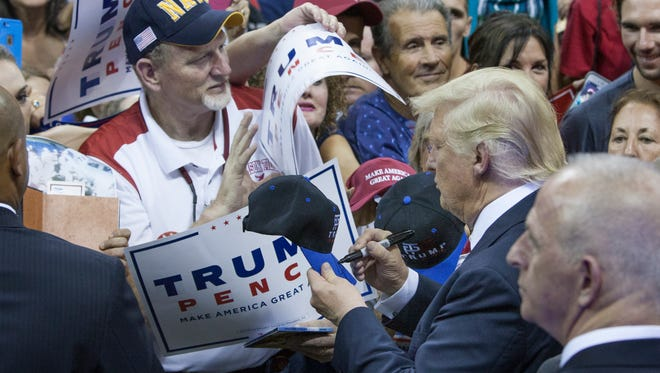Donald Trump signs autographs and shakes hands at the conclusion of his rally at the Pensacola Bay Center on Friday, September 9, 2016.