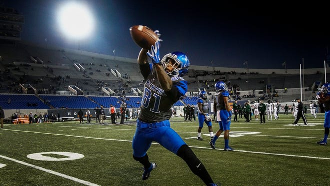 University of Memphis receiver Mechane Slade runs through drills while warming up as the Tigers prepare to take on University of South Florida at the Liberty Bowl Memorial Stadium.
