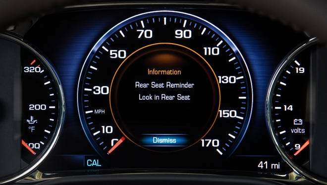 This photo shows the Rear Seat Reminder alert on the instrument panel of the 2017 GMC Acadia, a midsize SUV. The system monitors the Acadia'€™s rear doors. If either one is opened and closed within 10 minutes before the vehicle is started, or if they are opened and closed while the vehicle is running, the Acadia alerts the driver to check the back seat. GM plans to add the system to additional vehicles throughout its lineup in 2017.